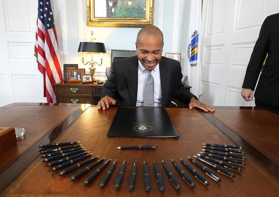 "Boston, MA 11/21/11 Governor Deval Patrick (cq) will use most of the assembled pens to sign H. 3798, ""An Act Establishing Congressional Districts,"" on Monday, November 21, 2011, at the State House. He used each pen to sign a part of his signature and he then handed out the pens to those involved with crafting the bill. (Pat Greenhouse/Globe Staff); Reporter: XXX; Section: Metro; Slug: 22Redistrict"